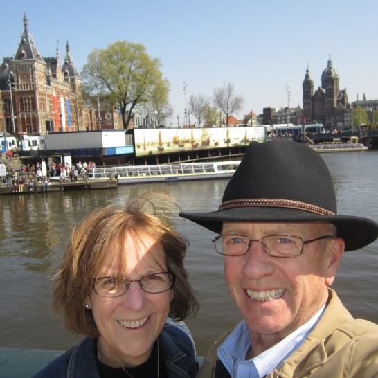 M'lady and I visit Amsterdam for an afternoon walk post-flight. The Central Railway Station and canal boat rides in the background.
