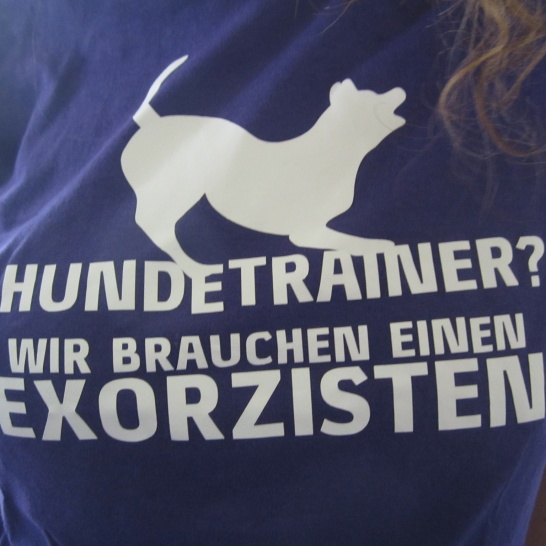 """Mareike trains dogs. Her shirt says """"Dog trainer? We need an exorcist!"""""""