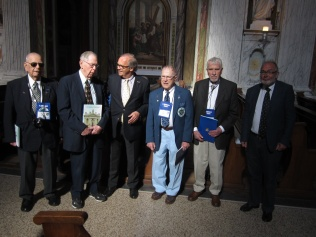 The vets receive souvenir books about the basilica.