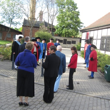 Welcoming group in traditional uniforms.
