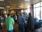Gathering in the lobby for departure.