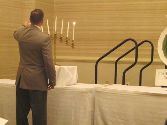 Lighting the candles in remembrance.