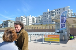 Our guide, John, and beachfront condos.