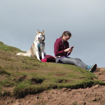 Woman with dog, seated by Arthur's Seat.